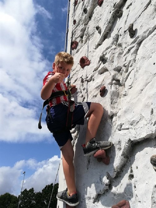 A young boy on a climbing wall